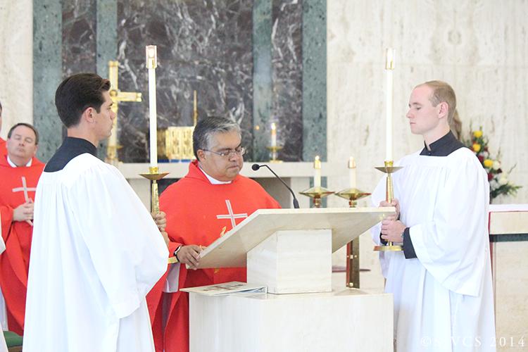Msgr. Roberto Garza proclaims the gospel
