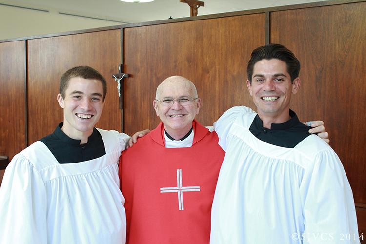 Senior Connor Penn and Junior Chris Grevenites join new spiritual director Fr. Art Proulx