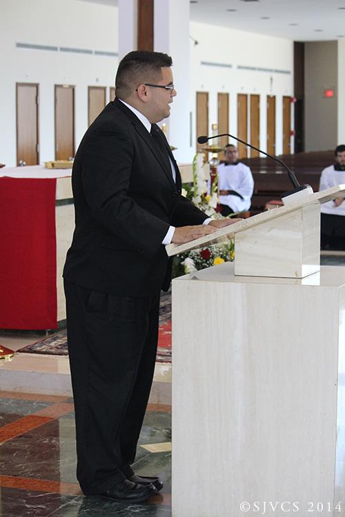 Senior Ricardo Salgado reads Paul's Letter to the Romans in Spanish