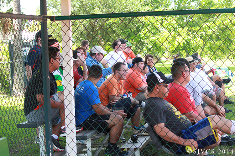 The crowd enjoys the softball tournament