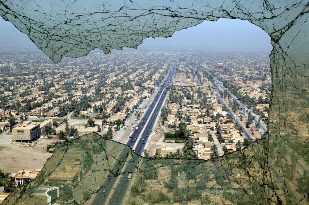 The city of Baghdad seen through the shattered window of the Tourism Tower that was bombed and looted during the war.