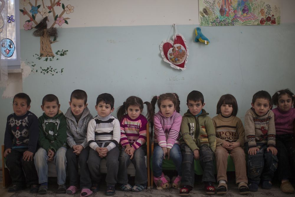 A number of Syrian-Armenian families relocated to the Kashatagh region of Nagarno-Karabakh, a disputed mountainous territory between Armenia and Azerbaijan.    Five year-old Avo, third from right, is the only Syrian-Armenian in his kindergarten.