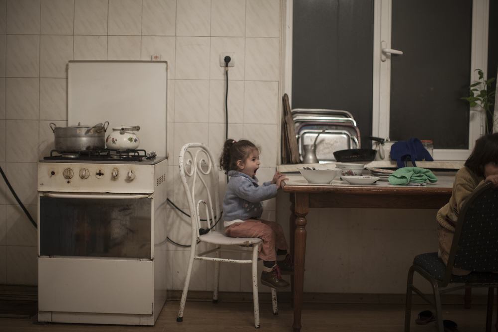 A young Syrian-Armenian girl in the kitchen of a building shared with a number of Syrian-Armenian families.