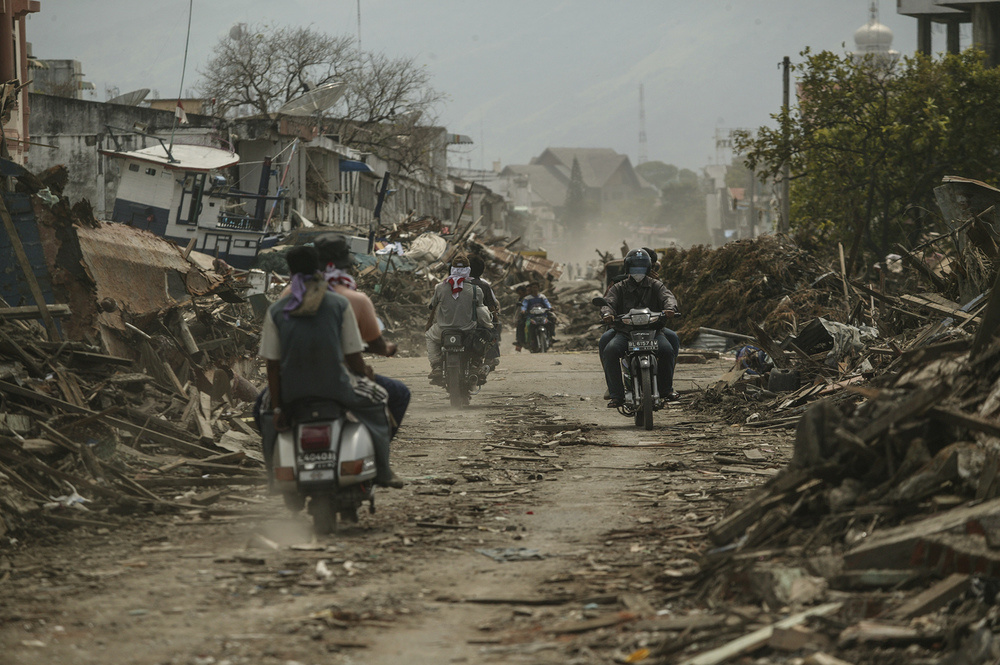 Residents of Banda Aceh ride through their town.