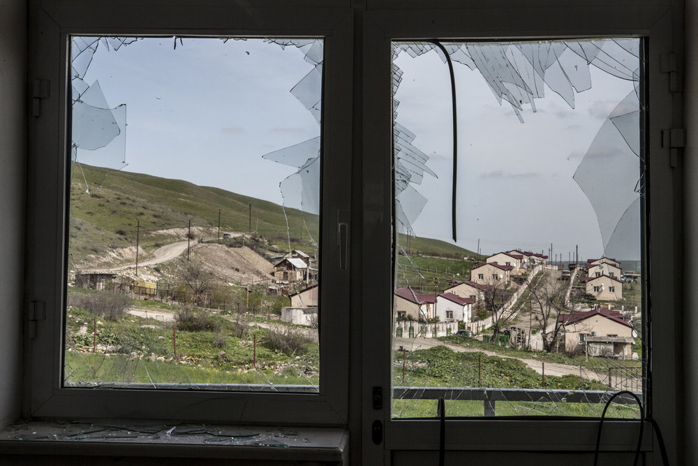 April 5- shattered windows of a school in the village of Mataghis where heavy shelling had taken place.