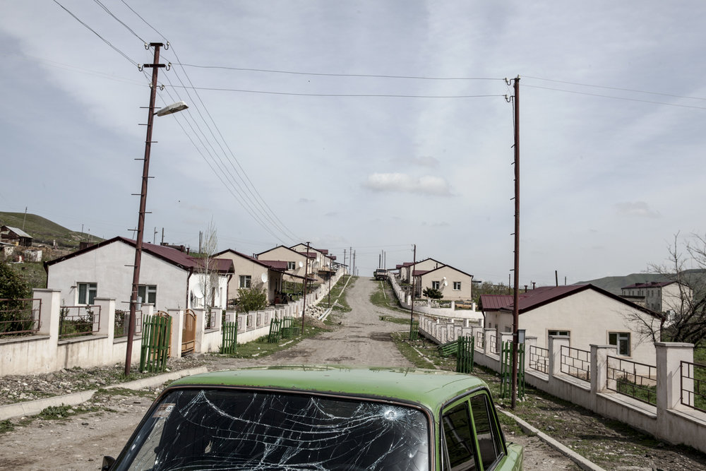 A road in the village of Mataghis with abandoned cars and houses shelled by Azerbaijani Army - April 5.