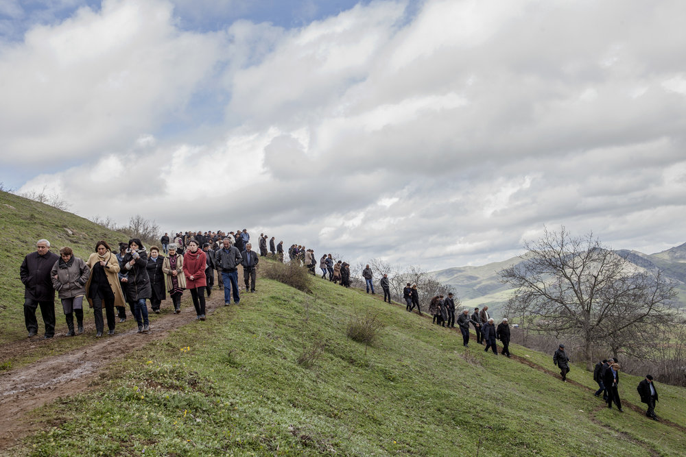 Locals of Herher village depart after funeral services for a boy killed on April 2 when Azeri Grad rockets hit their village during the first day of fighting.