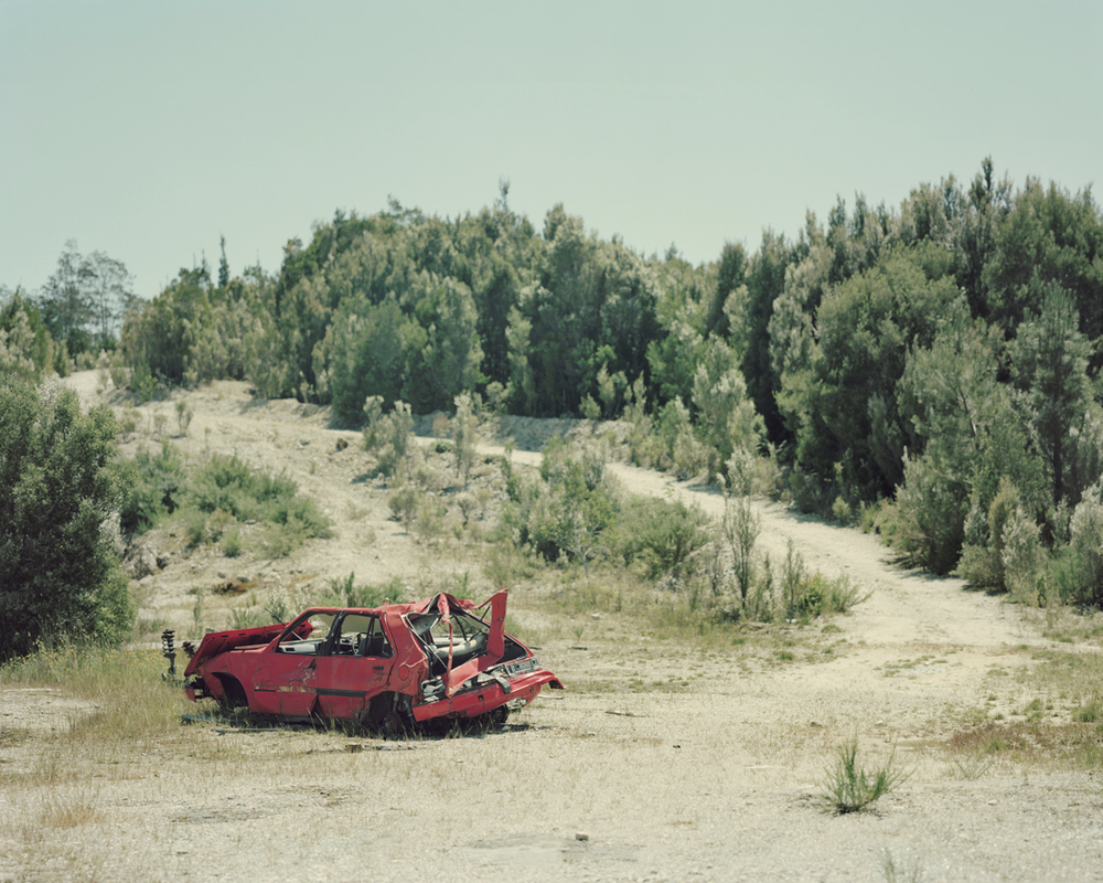 38_little-red-crushed-car.jpg