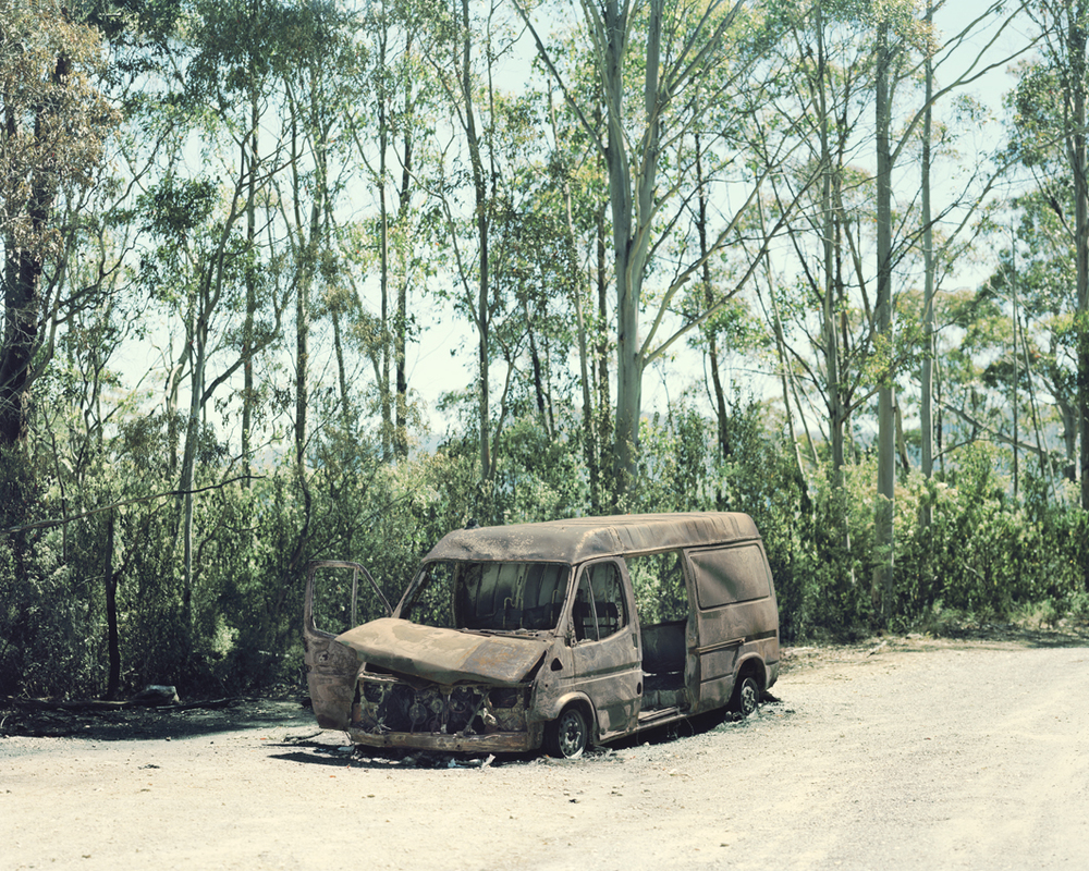 38_burnt-out-van-with-trees-1.jpg