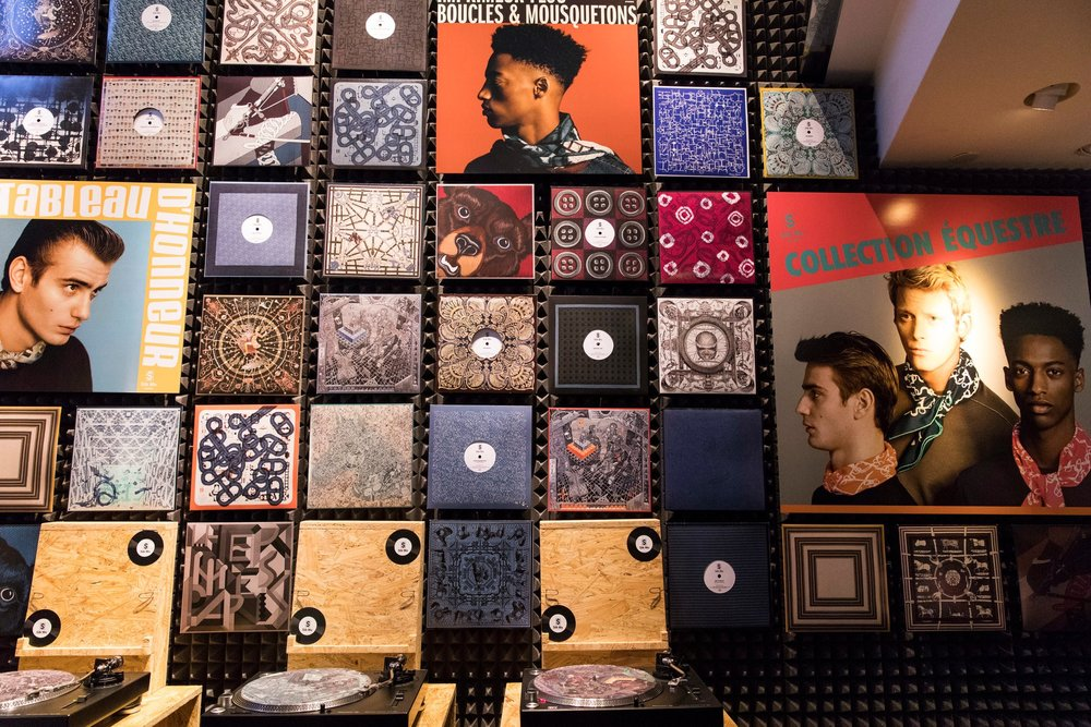 Hermès Record Store Day Installation - Custom hand lettered record dividers to coincide with matching Hermès scarves.Photo provided by New York Times photographer: Stefania Curto