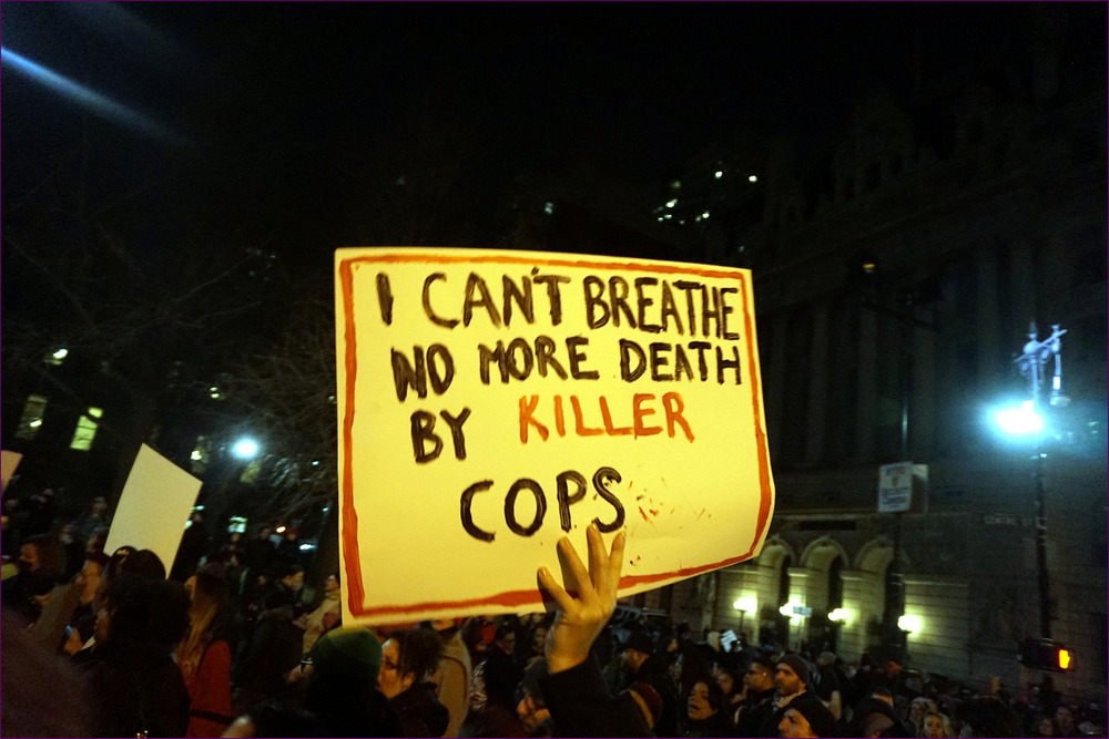 Image from a December 4, 2014 protest against a New York grand jury decision not to indict Daniel Pantaleo, the New York Police officer who killed Eric Garner; courtesy a creative commons license. Original photo availablehere.