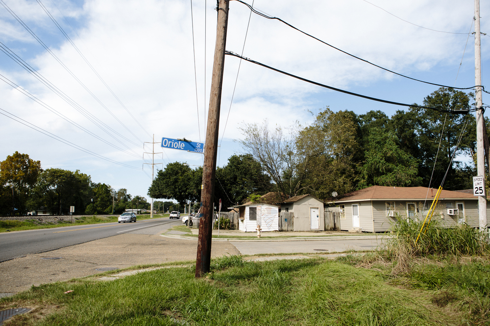 "Today, this span of Oriole Street and other nearby ""bird streets"" in Scotlandville are still lined with modest houses and tall trees, much as they were in 1963. On the day that Deputy Charles Hurt was murdered in a nearby park, roughly 300 law enforcement officer from neighboring parishes swarmed streets here, setting up roadblocks and detaining a few hundred black men as part of their investigation.  PHOTOS BY DAYMON GARDNER."
