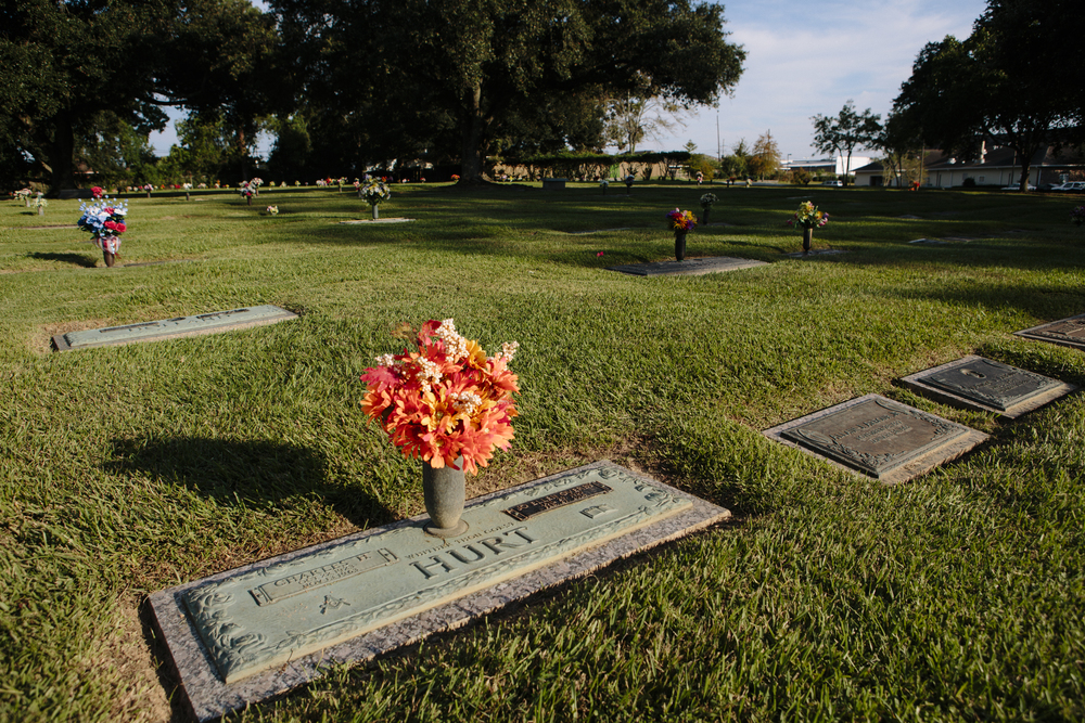 "Deputy Charles Hurt, the father of three young children, was buried in this plot in 1963, in Resthaven Gardens of Memory. His daughter Becky Wilson, who was 9 when her father was killed, filed a petition with the U.S. Supreme Court recounting how her family suffered as a result. She had a baby in high school who she gave up for adoption; her brother and sister dropped out of school. ""Charles Hurt did not get the chance to be a father to a family that needed him,"" she wrote."