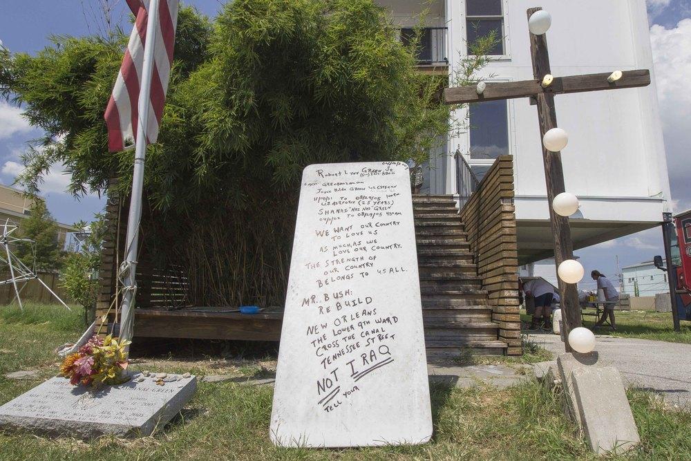 Memorials in front of Robert Green's house.