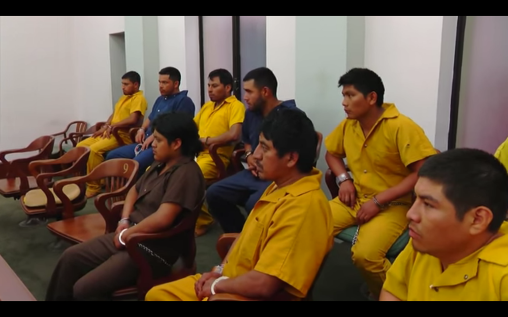 The nine men arrested in edwards during their bail hearing. still from KJTV video.