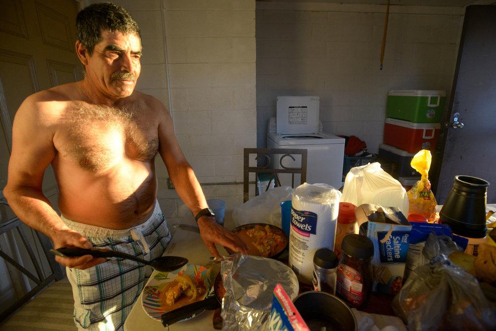 Alfredo Rodriguez prepares dinner for Galván.