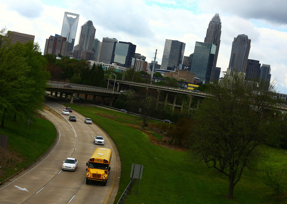 A yellow school bus passes through Charlotte during the afternoon commute. Photos by Travis Dove.
