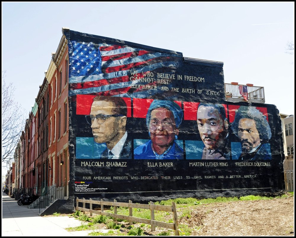 Civil rights leaders set against the American flag in a Philadelphia mural. Image courtesy Tony Fischer.
