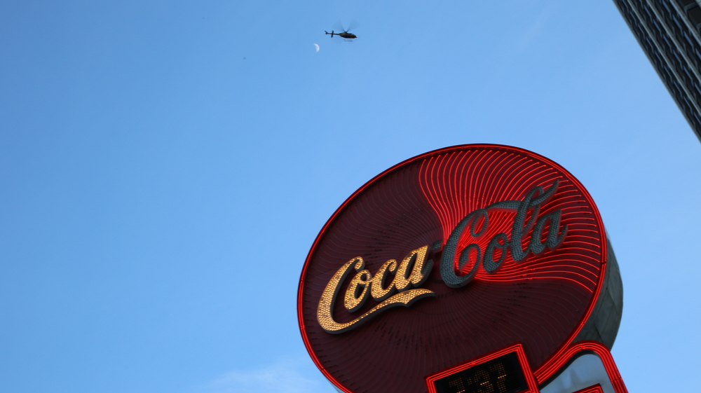 A police helicopter watches over an icon of corporate Atlanta. Credit: Camille Pendley.