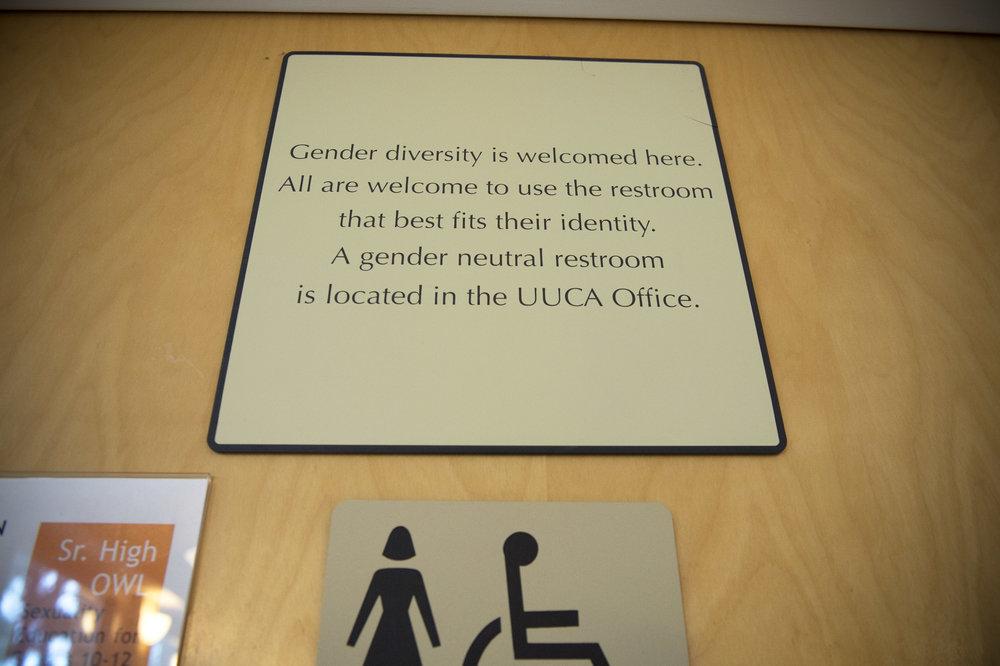 A sign on a Pride School Atlanta bathroom door.