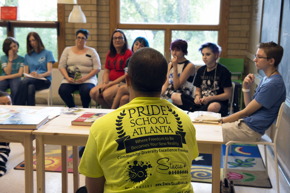 Christian Zsilavetz, the school's founder, meets with students and parents on first day of school to explain how the school will encourage learning in a safe space for all.