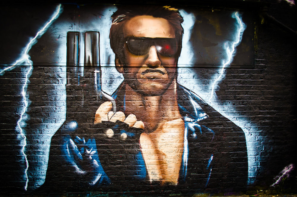 STREET ART PICTURING ARNOLD SCHWARZENEGGER'S CHARACTER IN THE TERMINATOR, A FILM IN WHICH HUMANITY FINDS ITSELF AT WAR WITH INTELLIGENT ROBOTS. COURTESY GARY KNIGHT.