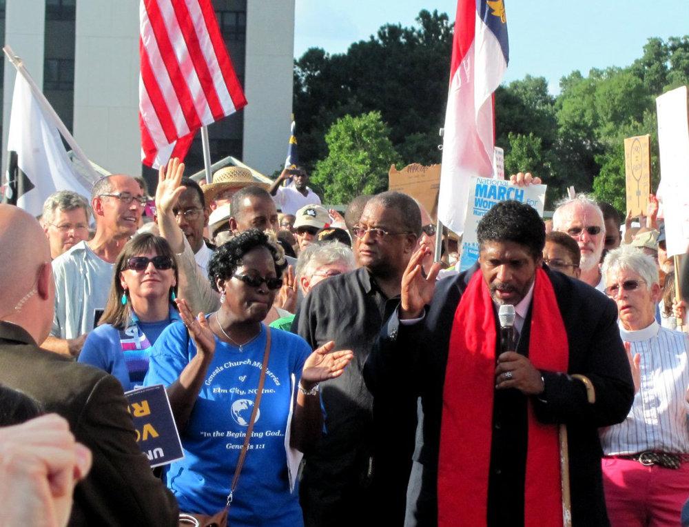 Reverend William Barber speaks at a Moral Monday rally in North Carolina. Image courtesy T.W. Buckner.
