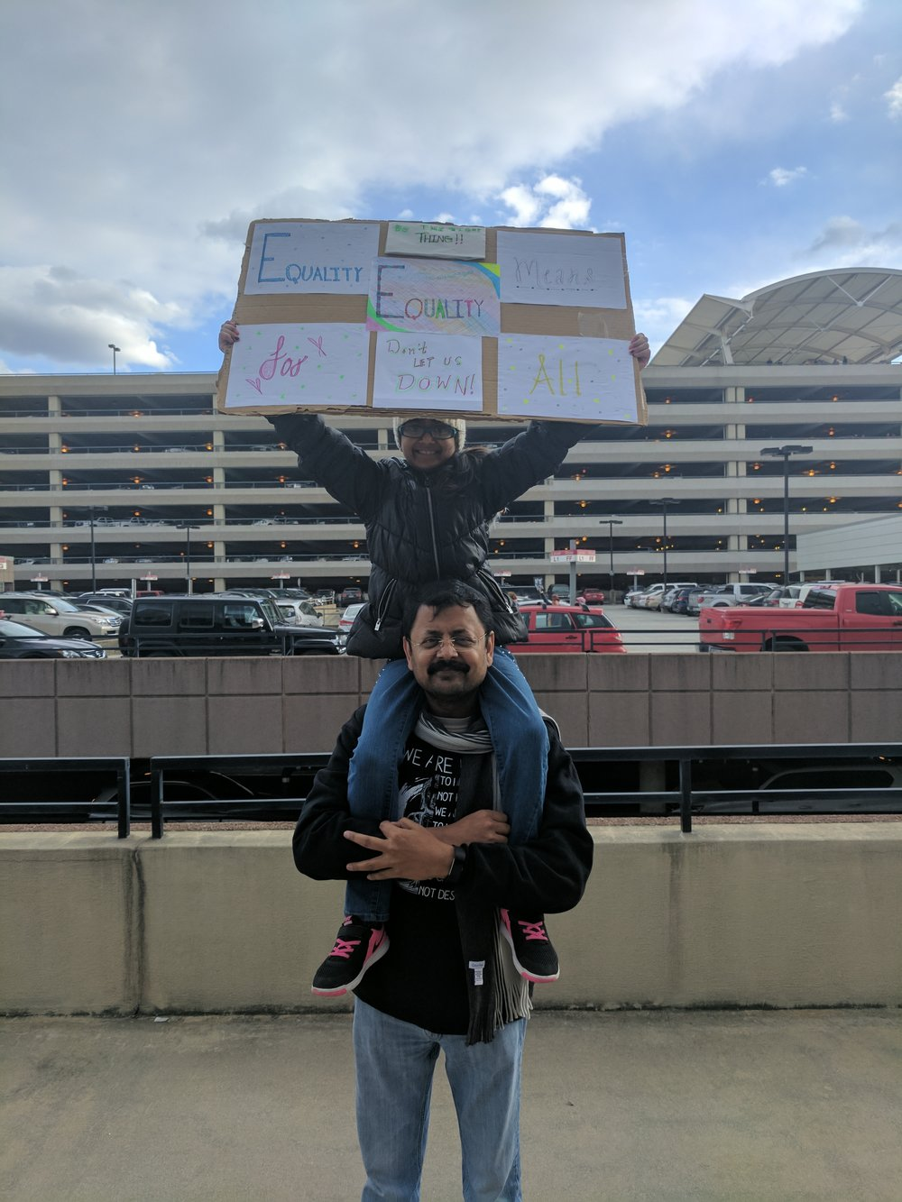 Sandeep (bottom) and Adaa protest at RDU.