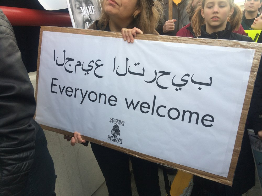 A sign among protesters at the Atlanta airport.