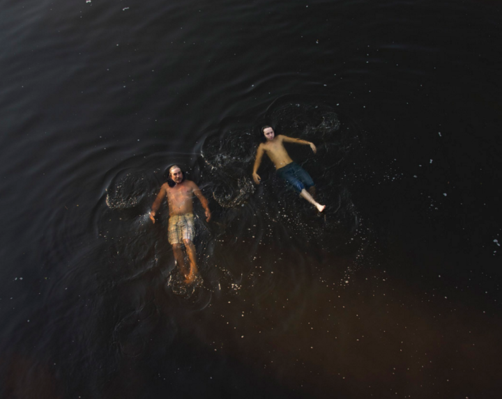 Two boys swim in the Ogeechee River. Photo by Stephen Milner.