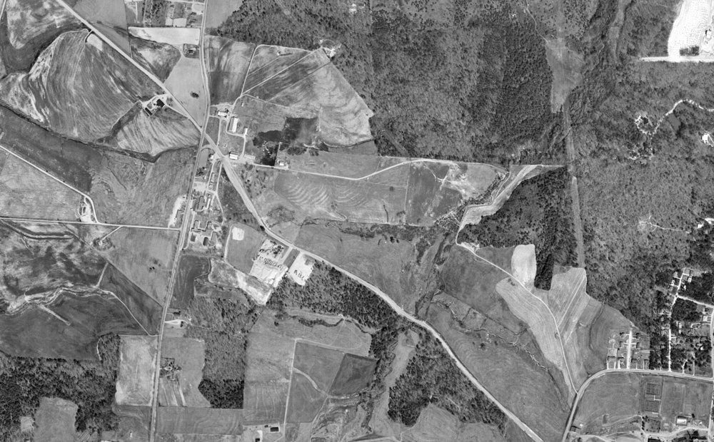 An historic aerial photograph of the NCMA site circa 1959. This photo shows the rural character of the site and predates Wade Avenue/I-40 construction. (photo credit: USDA via UNC Chapel Hill Library Historic Archives Collection)