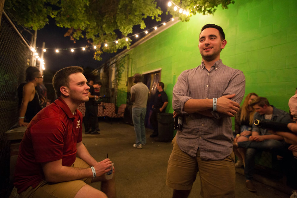 After a long week of work, Zach (left) and Tyler (right) spend Saturday night on Wonderlust's back porch. Photo by Imani Khayyam