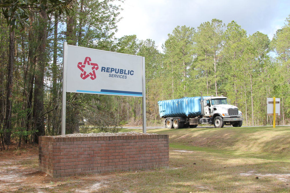 A waste-hauler pulls out of Republic Service's Broadhurst Environmental Landfill in Wayne County, Ga., in April. The company is the second largest waste management company in the United States, with revenues of more than $9 billion in 2015. The company's plan to bring coal ash into Wayne County stirred up a battle that ended with the company deciding to back out of the project a few days after this picture was taken. Photo by Georgina Gustin.