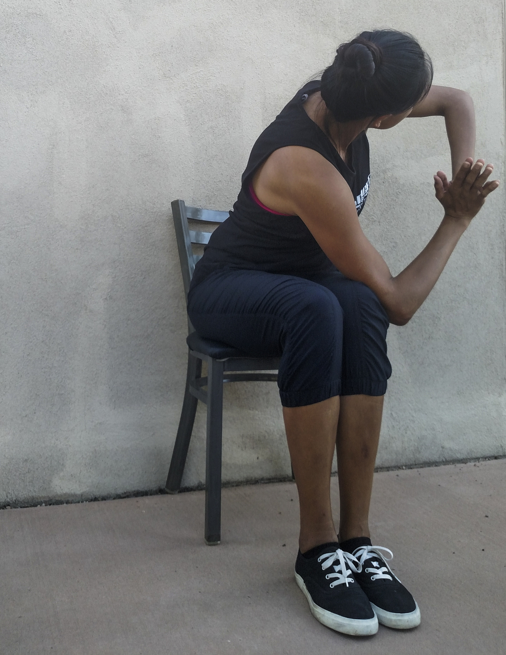 "Christine Means demonstrates ""Chair Pose Twist."""