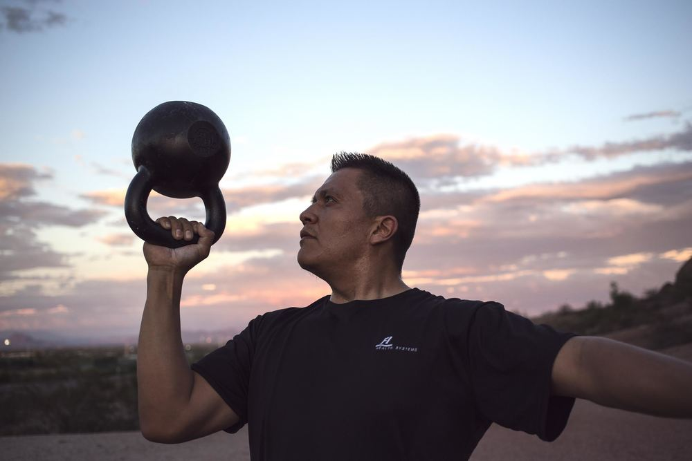 Strength and conditioning coach Dion Begay using one of his favorite tools - the kettlebell.