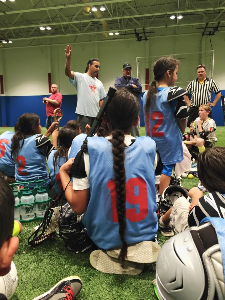 Twin Cities Native Lacrosse boys team with coach John Hunter at a scrimmage. Photo: Sasha Lee Brown.