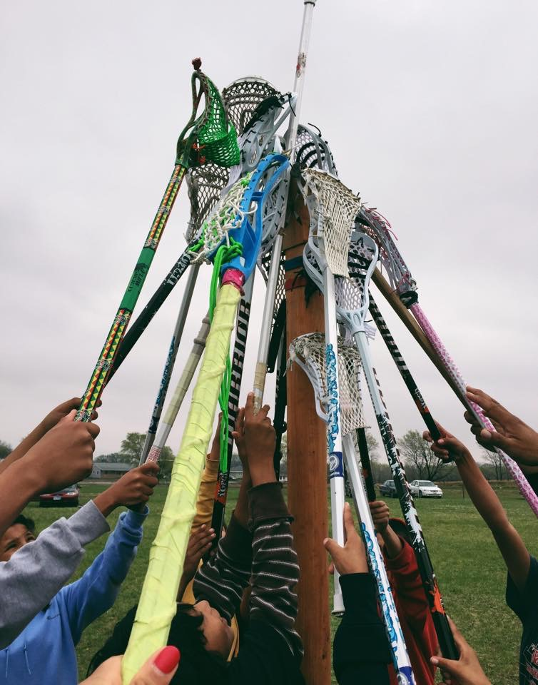Modern lacrosse sticks on a traditional Creator's pole. Twin Cities Native Lacrosse provides Indigenous youth the opportunity to learn both the modern and traditional game. Photo: Sasha Lee Brown.