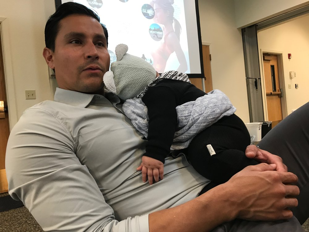 Thosh holds Alo while we present at a Native Wellness Institute event in Oregon.