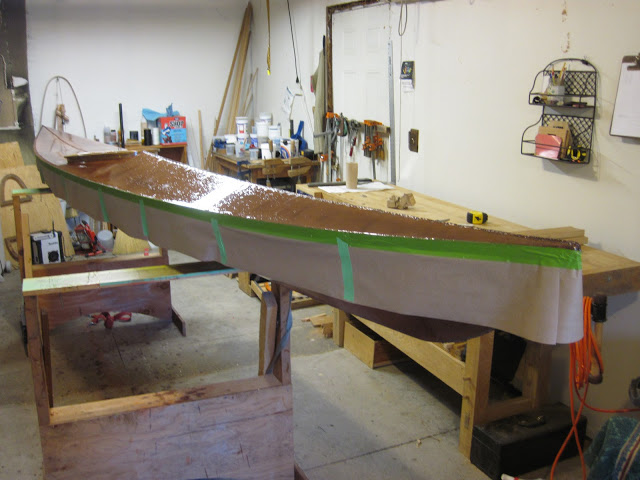 Here the kayak wears a skirt while the top is being gooped