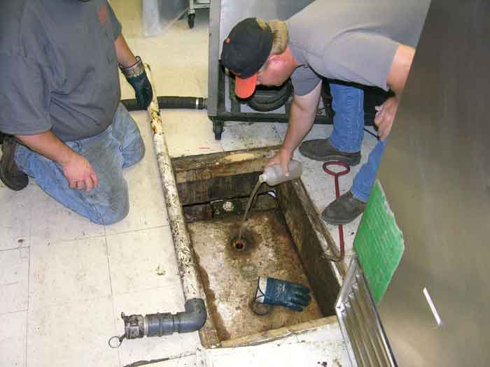 A problem grease trap being treated. Routine use of FOG-Pro can reduce costly service calls.