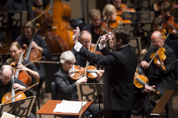 Associate conductor Brett Mitchell, seen here conducting The Cleveland Orchestra at Severance Hall, will preside over the centerpiece of the upcoming Hough Neighborhood Residency, a free community concert Thursday, Aug. 11. (Photo by Roger Mastroianni)