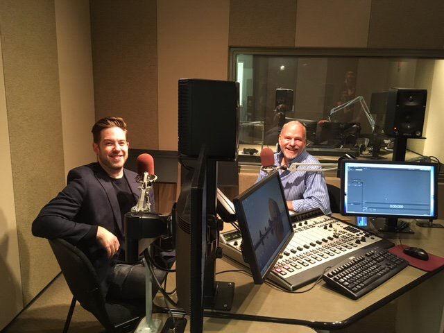 Colorado Symphony music director Brett Mitchell speaks with CPR Classical's David Rutherford at the Colorado Public Radio studios. (Photo by Rachel Trignano)