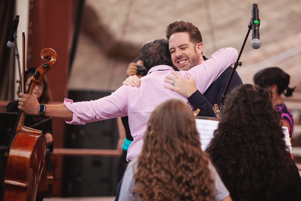 Brett Mitchell greets Yo-Yo Ma at Red Rocks Amphitheater in Morrison, CO. (Photo by Amanda Tipton)