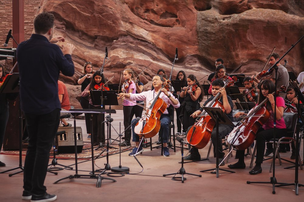 Brett Mitchell leads Yo-Yo Ma and El Sistema Colorado in a rehearsal of Bach's  Air on a G String  at Red Rocks Amphitheater in Morrison, CO. (Photo by Amanda Tipton)