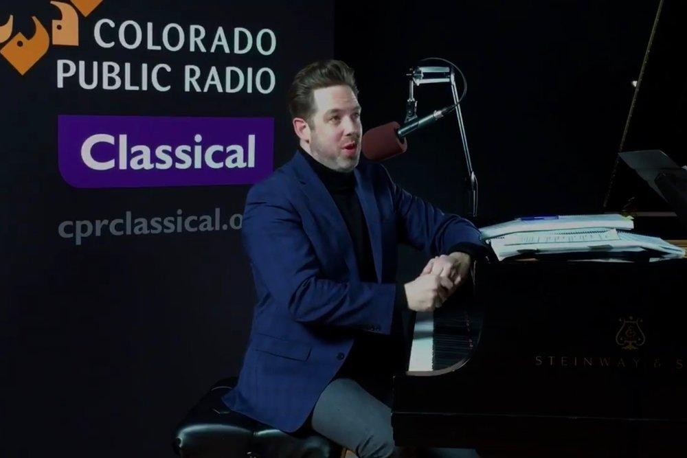 Brett Mitchell at the piano in the Colorado Public Radio studios. (Photo by Hart Van Denburg/CPR)
