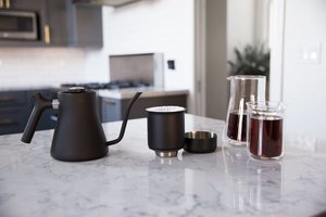 """""""Coffee Lover"""" * Stagg Pour Over Kettle & Stagg Dripper * Monthly delivery of HOPE HEALS blend coffee (1 pound) for 3-MONTHS By The Conservatory for Coffee & Tea * Blue Bottle Coffee $50 Gift Card"""