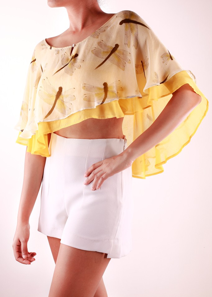 DRAGONFLY CAPE   A hot trend this summer, this delicate cape in the 'Dragonfly' print is paired with mustard yellow. The light fabric layers give it a soft feminine look, making it a perfect match for that white summer dress. It is made from 100% Silk Chiffon and Modal.  SOLD OUT  Code : 0049CP