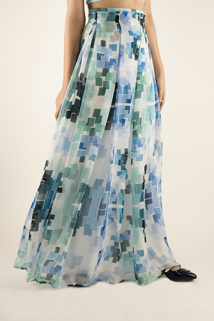 PRINTED CHIFFON SKIRT   Light and carefree, this beautiful skirt in the 'Blues' print has delicate detailing along the waist and flows freely towards the hemline. Made from 100% Silk chiffon and lined with a soft silk lining. Dry Clean Only.  SOLD OUT  Code : 0039LS