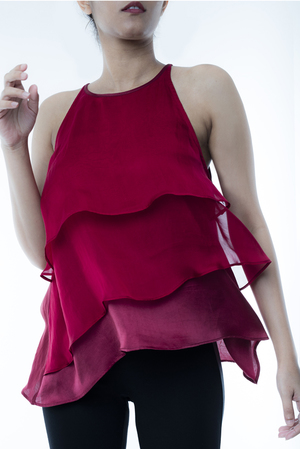 MAROON LAYERED TOP   This top is perfect for a night out, made from silk chiffon it flows beautifully and the palette transforms from light to dark maroon. Made from 100% silk, dry clean only.  Code : 0032LTM