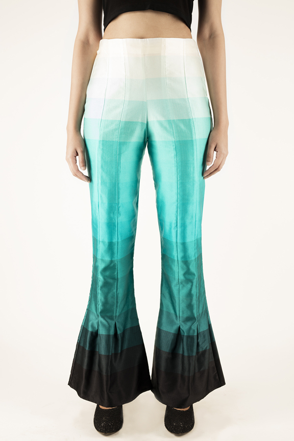 PLEATED BELL BOTTOMS   These modern bell bottoms have seam details in the front and back. They come in the 'Teal Sunrise' print and are made from luscious Cotton Silk Satin Fabric. They are high waist and have an invisible zipper closure. Dry clean only.  SOLD OUT  Code : 0034PBB